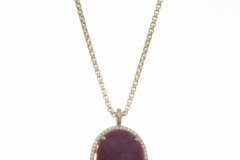 9.8 carat Natural Oval Cabochon Cut Ruby with Diamond Bezel.  Set in 14K Yellow Gold with Hallmarks on inside of Shank.  Original Design by Steven Zale